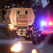 Law enforcement officers leave after calling off the search for suspect Markeith Loyd at the Tzadik Brookside Apartments on January 9 2017 in Orlando, Florida. Loyd shot an Orlando Police officer earlier in the day at a local Walmart, the officer has since died.  (Alex Menendez via AP)