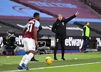 Football - 2020 / 2021 Premier League - West Ham United vs Brighton & Hove Albion - London Stadium<br /> <br /> Brighton & Hove Albion Head Coach Graham Potter shouts instructions to his team from the technical area.<br /> <br /> COLORSPORT/ASHLEY WESTERN