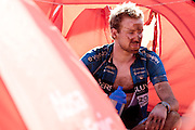 An exhausted rider recovers at his tent after stage 2 of the 2011 Absa Cape Epic Mountain Bike stage race held from Saronsberg Wine Estate in Tulbagh, South Africa on the 29 March 2011..Photo by Greg Beadle/Cape Epic/SPORTZPICS