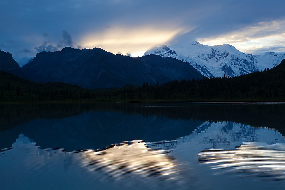Reflections of Mount Blackburn at sunset in a lake in Donoho Basin, Wrangell-St. Elias National Park, Alaska.
