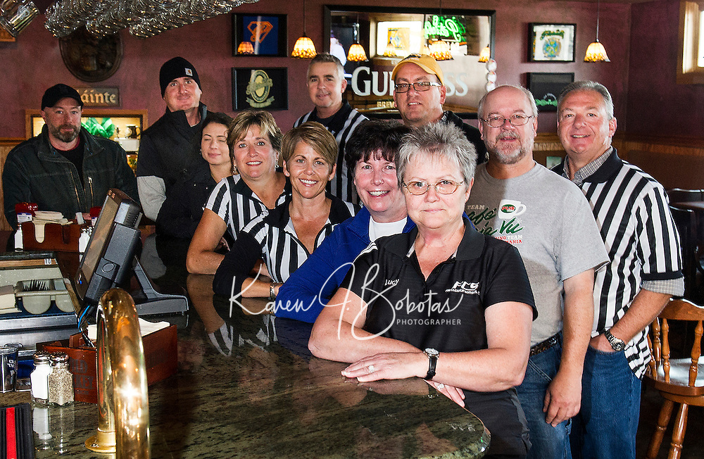 """Returning team members and the """"official"""" referrees get prepped for the Pub Mania event at Patrick's Pub and Eatery to benefit the Children's Auction to begin on December 8th.  (l-r Keith McBey, Matt Resca, Ashley Riopel, Allan Beetle, Jennifer Bailey, Jennifer Beetle, Randy Remick, Marcia Wadsworth, Tony Felch, Shawn Bailey and Lucy Jacobson).  (Karen Bobotas/for the Laconia Daily Sun)"""