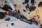 Member of the Free Syrian Army (FSA) appears to be cleaning muzzles and pipes of a dissassembled anti-air machine gun that was captured from the forces loyal to President Al-Assad in Anadan on Monday, June 25, 2012. Anadan bears the scars from Syrian President Bashar al-Assad's use of military force to crush an opposition movement that has spawned an armed insurgency against his rule. (Photo by Vudi Xhymshiti)