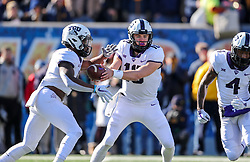 Nov 10, 2018; Morgantown, WV, USA; TCU Horned Frogs quarterback Michael Collins (10) hands the ball off to TCU Horned Frogs running back Darius Anderson (6) during the first quarter against the West Virginia Mountaineers at Mountaineer Field at Milan Puskar Stadium. Mandatory Credit: Ben Queen-USA TODAY Sports