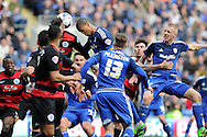 Cardiff City's Lee Peltier (c) heads just wide from a corner. Skybet football league championship match, Cardiff city v Queens Park Rangers at the Cardiff city stadium in Cardiff, South Wales on Saturday 16th April 2016.<br /> pic by Carl Robertson, Andrew Orchard sports photography.