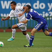Diego Reyes, Honduras, (left), is tackled by Shpungin Yuval, Israel, in action during the Israel V Honduras  International Friendly football match at Citi Field, Queens, New York, USA. 2nd June 2013. Photo Tim Clayton