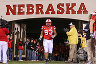 Ndamukong Suh runs out of the tunnel on Senior Day at Memorial Stadium prior to Nebraska's game against Kansas State on Nov. 21, 2009. © Aaron Babcock