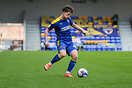 AFC Wimbledon midfielder Alex Woodyard (4) passing the ball during the EFL Sky Bet League 1 match between AFC Wimbledon and Sunderland at Plough Lane, London, United Kingdom on 16 January 2021.