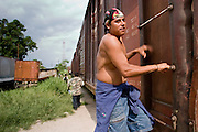 27 JULY 2004 --  TAPACHULA, CHIAPAS, MEXICO:  Illegal immigrants from Central America in Mexico try to hop freight trains north to the interior of Mexico on their way to the United States. Tapachula is center of the smuggling industry between Mexico and Guatemala. Consumer goods are smuggled south to Guatemala (to avoid paying Guatemalan import duties) and people are smuggled north into Mexico. Most of the people coming north are hoping to eventually get to the United States.   PHOTO BY JACK KURTZ