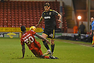 AFC Wimbledon midfielder Anthony Wordsworth (40) makes a tackle during the EFL Sky Bet League 1 match between Walsall and AFC Wimbledon at the Banks's Stadium, Walsall, England on 12 February 2019.