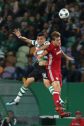 November 22, 2017 - Lisbon, Portugal - Sporting's midfielder Rodrigo Battaglia from Argentina heads the ball with Olympiacos' Belgian midfielder Guillaume Gillet (R ) during the UEFA Champions League group D football match Sporting CP vs Olympiacos FC at Alvalade stadium in Lisbon, Portugal on November 22, 2017. (Credit Image: © Pedro Fiuza/NurPhoto via ZUMA Press)