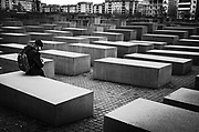 I had mixed feelings about posting this one, but ultimately decided to share it as it affected me in ways I'm still processing.  This is the Memorial to the Murdered Jews of Europe - the Holocaust Memorial.  There are 2,711 columns.  It's a stark, haunting place.  A place for reflection and remembrance.  I'm not sure that this man was sitting and dwelling on the horror and tragedy that befell the Jews, but I'd like to hope he was.