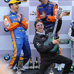SunTrust Racing team owner Wayne Taylor rocks out after receiving a custom guitar on the podium following victory in the Grand-Am Rolex Sports Car Series Championship Race at Lime Rock Park in Lakeville, Conn.