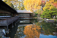 """Teahouse at the pond garden of Shosei-en - Rinchi-tei on the left and Tekisui-ken to its right. Shosei-en Garden was designed as a retreat for the chief priest Sen'nyo.  Shosei-en is also called Kikoku-tei """"Orange Mansion"""" because it was once surrounded by orange groves. The garden is a Chisen Kaiyu Shiki teien, that is, a pond strolling garden with buildings such as tea-ceremony houses arranged throughout the grounds."""