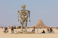 Robot Resurrection by: Shane Evans from: Denver, CO year: 2018<br /> <br /> Robot Resurrection is towering 30 foot tall, human piloted, articulating sculpture made from reclaimed airplane parts and found objects. From the torso cockpit, the operator(s) manipulate the Robot's motions and fire effects. This piece is a representation of we all have become… Robots. It is a wake-up call of how large these problems are. We have been controlled for too long. Robot Resurrection was born from what we as a society have discarded. Our hope is that this 28′ Robot will inspire reflection upon one's self and be a reminder of the power we all hold. We hope it awakens some awareness of our situation and encourages some small change on a small scale that leads to big change in the massive system. Contact: ourbigrobot@gmail.com