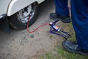 Foot pump pumping caravan tyre