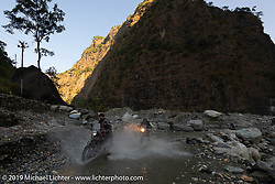 Led Sled's Pat Patterson and Gary Thomas navigate another water crossing on his Royal Enfield Himalayan on Motorcycle Sherpa's Ride to the Heavens motorcycle adventure in the Himalayas of Nepal. On the sixth day of riding, we went from Tatopani to Pokhara. Saturday, November 9, 2019. Photography ©2019 Michael Lichter.