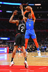 March 9, 2019 - Los Angeles, CA, U.S. - LOS ANGELES, CA - MARCH 08: Oklahoma City Thunder Guard Russell Westbrook (0) shoots over Los Angeles Clippers Guard Shai Gilgeous-Alexander (2) during a NBA game between the Oklahoma City Thunder and the Los Angeles Clippers on March 8, 2019 at STAPLES Center in Los Angeles, CA. (Photo by Brian Rothmuller/Icon Sportswire) (Credit Image: © Brian Rothmuller/Icon SMI via ZUMA Press)