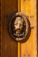 Ornate Paris Door Knocker - Thousands of doors and gates adorn buildings in Paris.  Some of the best are on government offices, cathedrals and churches, as well as a few chateau.  However, any self-respecting contractor with a decent budget probably spent a lot of consideration in installing suitable doors, windows, grill work and even doorknobs. Some of these gates, doors and windows are very simple, while others are extravagant works of art. The styles of these doors tell about the history of France. As you walk across the 20 arrondissements of Paris, you will discover Gothic, Renaissance, Haussmann and Art Nouveau door styles. It is up to you to take the time to look for little details of these Paris' most beautiful doors with statues, bas-reliefs, mascarons, gold-leaf, grills, handles and door knobs.