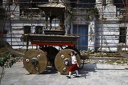 September 1, 2017 - Kathmandu, Nepal - A school girl offers prayers on the wheels of a chariot placed for upcoming Indra Jatra festival in Kathmandu, Nepal on Friday, September 01, 2017. (Credit Image: © Skanda Gautam via ZUMA Wire)