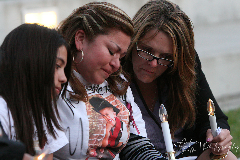 /Andrew Foulk/ For the Californian/.Cammie Dudak, with Victim services consoles Zorayda juarez, whos son  Javiersito, was killed at the age of four, during a candlelight vigil in Temecula as part of National crime victims' rights week.