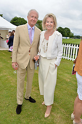 GALEN & HILARY WESTON at the Cartier Queen's Cup Final polo held at Guards Polo Club, Smith's Lawn, Windsor Great Park, Egham, Surrey on 15th June 2014.