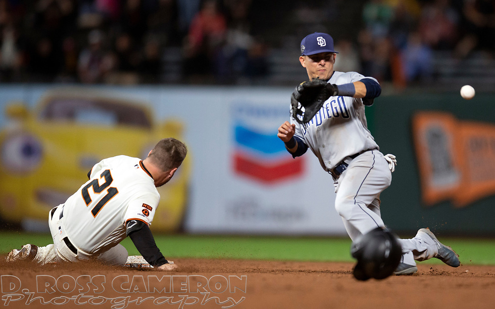San Francisco Giants pinch hitter Stephen Vogt (21) slides safely into second with an RBI double as San Diego Padres shortstop Luis Urias fields the late relay during the ninth inning of a baseball game, Thursday, Aug. 29, 2019, in San Francisco. The Padres won 5-3. (AP Photo/D. Ross Cameron)