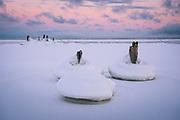 The mixture of ice and snow growing around remaining parts of abandoned pier in morning dawn at seacoast, near Mazirbe, Slitere National Park (Slīteres Nacionālais parks), Latvia Ⓒ Davis Ulands | davisulands.com