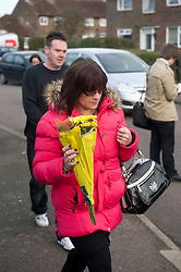 © Licensed to London News Pictures. 28/12/2011 Borehamwod, UK. .Neighbours leave floral tributes to babysitter Katie Briscoe, 19 was stabbed to death while looking after her nephew and neice at her sisters house at Beech Drive, Borehamwood, Hertfordshire..Photo credit : Simon Jacobs/LNP