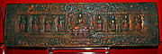 Buddhist book cover painted and gilded wood.  Tibet around 1000. This book cover depicts the Buddha seated on a lion throne attended by eight Bodhisattvas.