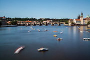 Rented pedal boats on the Moldau (Vltava) river with Prague's Charles Bridge in the back.