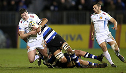 Exeter's Ian Whitten is tackled by Bath's Charlie Ewels and Taulupe Faletau during the Aviva Premiership match at the Recreation Ground, Bath.