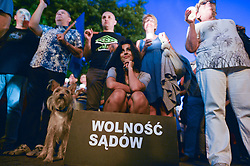July 23, 2017 - Rzeszow, Poland - A young lady holds a 'Freedom of Courts' sign during anti-government protest - a candle-lit vigil in front of Rzeszow's District Court on Sunday evening in solidarity with other Polish towns demanding for Polish President veto the proposed judical reform..On Sunday, July 23, 2017, in Rzeszow, Poland. (Credit Image: © Artur Widak/NurPhoto via ZUMA Press)