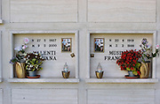 Cemetery in Radicofani, Italy (near Pienza) with photos on a gravestone.