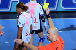 Referee with yellow card at handball match of 2nd Round of EHF Women`s Championsleague between RK Krim Mercator (SLO) and Metz Handball (FRA), in Arena Kodeljevo, Ljubljana, Slovenia, on November 9, 2008. Metz  won match against RK Krim Mercator with 31:26.