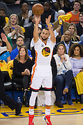 Golden State Warriors guard Stephen Curry (30) shoots a jumper against the LA Clippers at Oracle Arena in Oakland, Calif., on January 28, 2017. (Stan Olszewski/Special to S.F. Examiner)