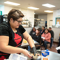 Andi Murphy, host of Toasted Sister podcast mixing ingredients for a bison meatloaf during a cooking demo Friday, Feb. 1 at Navajo Technical University.