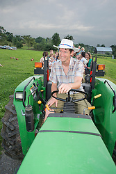 Seth drives a hay wagon full of party goers in Vermont, USA.