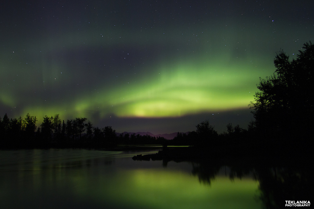 The aurora borealis, or northern lights, over the Knik River in Southcentral Alaska.