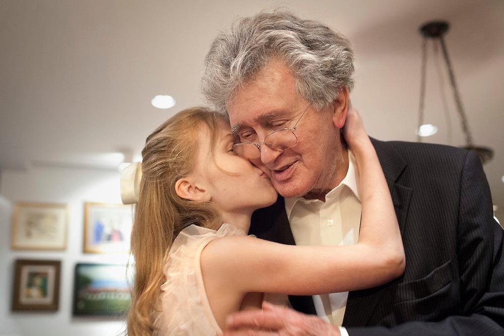 Katrin Kristjansdottir kisses her grandfather Gunnar Eyjolfsson as he arrives from Christmas dinner in Reykjavik, Iceland on December 25, 2013.
