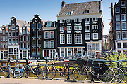 Canalside ornate gabled houses - Dutch gables - and bicycles in canal district in Jordaan, Amsterdam
