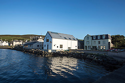 Scalloway is the largest settlement on the North Atlantic coast of Mainland, Shetland, with a population of approximately 812, at the 2001 census. Until 1708 it was the capital of the Shetland Islands (now Lerwick, on the east coast of the Shetland Mainland).