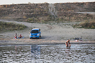People enjoy a late summer day on the banks fo the Dniester River on the outskirts of Tiraspol, Transnistria.<br /> <br /> (September 10, 2016)