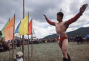 "Mongolian wrestling (Mongolian: bökh) is a traditional sport that has existed in Mongolia for centuries.<br /> Wrestling is one of Mongolia's age-old ""Three Manly Skills"" (along with horsemanship and archery).<br /> The wrestler is dressed in an open-chested wrestling shirt, called a zodog.<br /> Mongolian's nomadic lifestyle and traditions."