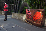Brightly painted with cocoa bean design, a telecoms junction box on Bermondsey Street in South London. This street is becomming a very fashionable area in a once quiet and almost desolate street. With arts galleries, and street art such as this popping up, and good eating establishments the area is one of London's best secrets.