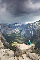Young woman hiking the Yosemite Falls trail. Yosemite National Park, CA