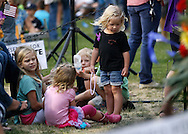 Children in the section reserved for immediate family of the 19 firefighters killed in a nearby wildfire play before a prayer vigil ceremony in Prescott, Arizona July 2, 2013. REUTERS/Rick Wilking (UNITED STATES)