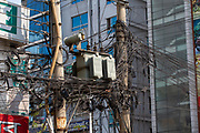 A chaotic electricity transformer box surrounded by wires and cables up a pylon on the street in Tejgaon railway district of Dhaka on the 2nd of October 2018 in Dhaka, Bangladesh. (photo by Andrew Aitchison / In pictures via Getty Images)