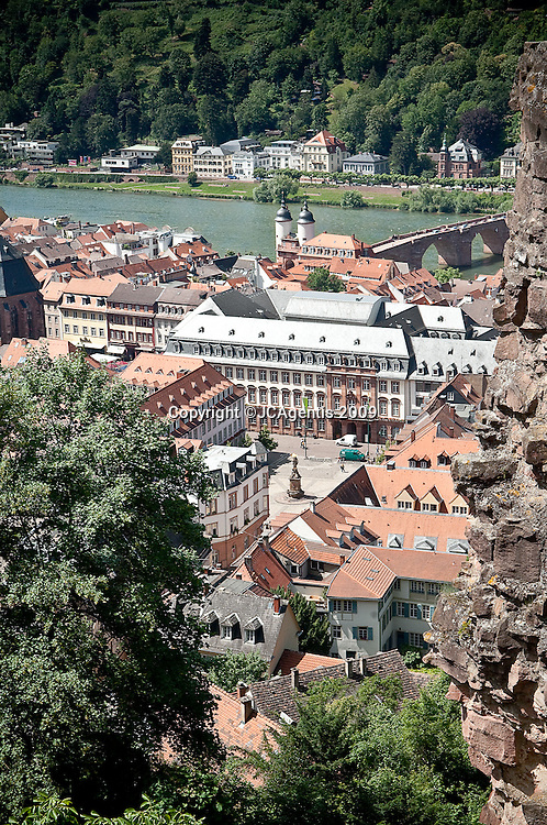 View of the town of Heidelberg from the Heidelberg Castle with their red clay rooftops overlooking the River Neckar.