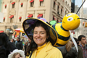 A woman with a bee on her bonnet. Many of the hats in the parade featured birds, bugs and flowers.