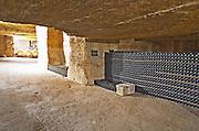 Bottles aging in the cellar. An old quarry. Chateau Clos Fourtet, Saint Emilion, Bordeaux, France